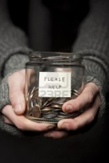 8481887-close-up-of-a-beggars-hands-and-jar-of-coins