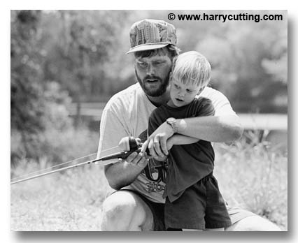 father-teaching-son-to-fish-J111-30-836